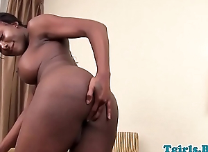 Busty nubian tranny fingering herself