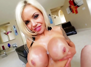 Nina Elle stroking cock with her massive tits