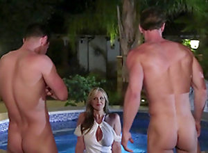 Busty cougar Julia Ann not shy to flirt with four handsome pool guys