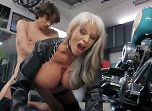 Sally D'Angelo gets pounded by young Ricky Spanish next to the brush Harley