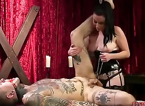 Weirdo domina strapon-fucks her slave